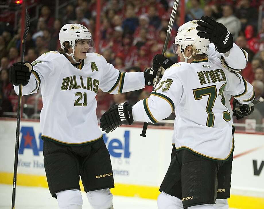 Dallas Stars right wing Michael Ryder (73) celebrates his goal against the Washington Capitals with teammates left wing Loui Eriksson (21) and defenseman Sheldon Souray (44), back, in the first period at the Verizon Center in Washington, D.C., Tuesday, November 8, 2011. (Chuck Myers/MCT) Photo: Chuck Myers, MCT