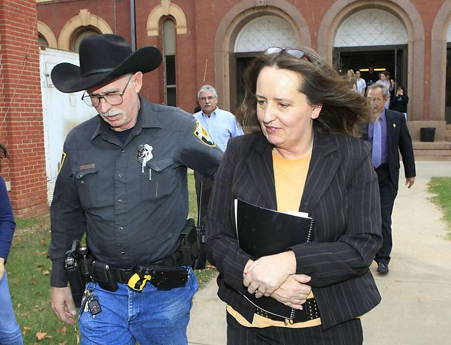 Bobbi Parker is lead from the Greer County Courthouse in Mangum after her sentencing, Monday, Nov. 7, 2011. Parker was sentenced to a year in prison for helping a convicted murderer escape from prison in 1994. (AP Photo/The Oklahoman, David McDaniel) Photo: David McDaniel, AP