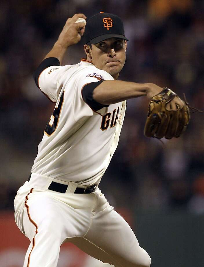 In this photo taken Sept. 13, 2011, San Francisco Giants pitcher Javier Lopez delivers against the San Diego Padres during a baseball game in San Francisco. A person with knowledge of the negotiations says left-handed reliever Lopez has agreed to an $8.5 million, two-year contract to stay with the Giants. (AP Photo/Jeff Chiu)  Ran on: 11-06-2011 Javier Lopez signed a two-year, $8.5 million deal. Ran on: 11-06-2011 Javier Lopez signed a two-year, $8.5 million deal. Photo: Jeff Chiu, AP