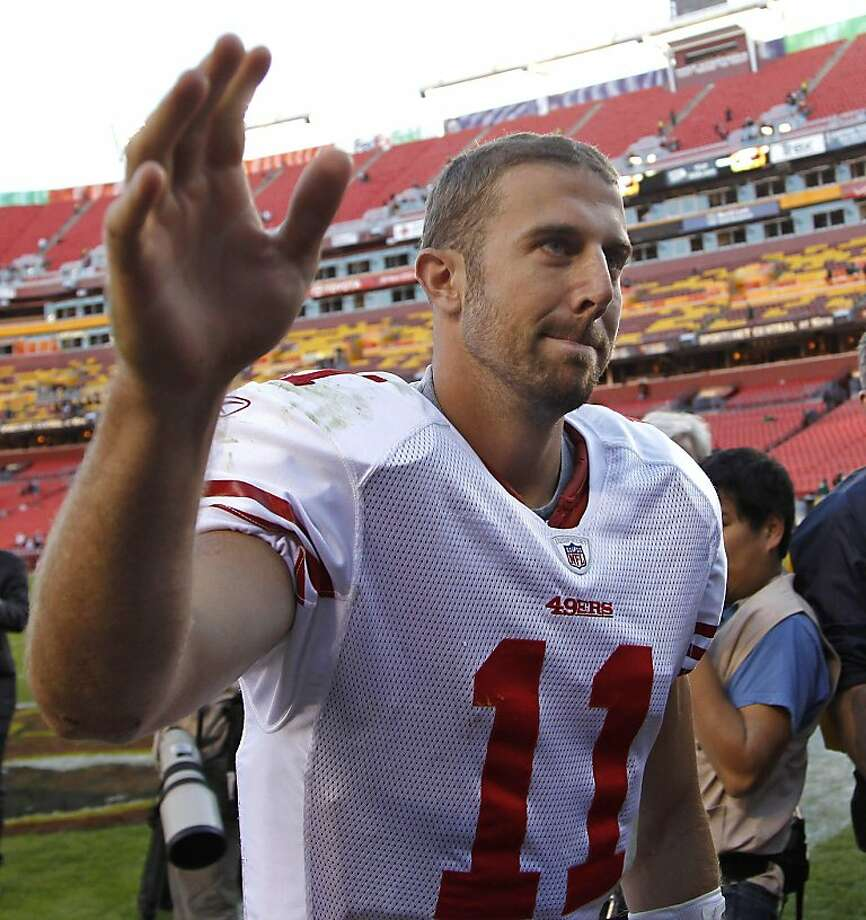 San Francisco 49ers quarterback Alex Smith acknowledges fans as he walks off the field after an NFL football game against the Washington Redskins in Landover, Md., Sunday, Nov. 6, 2011. San Francisco won 19-11. (AP Photo/Pablo Martinez Monsivais)  Ran on: 11-08-2011 The 49ers' Alex Smith acknowledges fans after Sunday's win in Washington. Ran on: 11-08-2011 The 49ers' Alex Smith acknowledges fans after Sunday's win in Washington. Photo: Pablo Martinez Monsivais, AP
