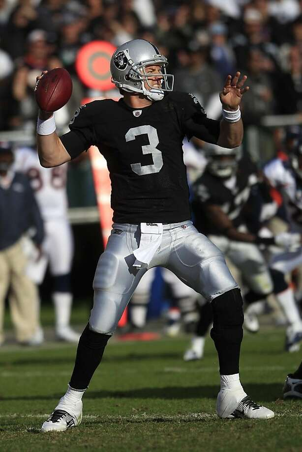 Oakland Raiders quarterback Carson Palmer (3) passes against the Denver Broncos in the third quarter of an NFL football game in Oakland, Calif., Sunday, Nov. 6, 2011. (AP Photo/Marcio Jose Sanchez)  Ran on: 11-10-2011 Carson Palmer's pickoffs are due mainly to timing issues with his receivers. Ran on: 11-10-2011 Carson Palmer's pickoffs are due mainly to timing issues with his receivers. Photo: Marcio Jose Sanchez, AP