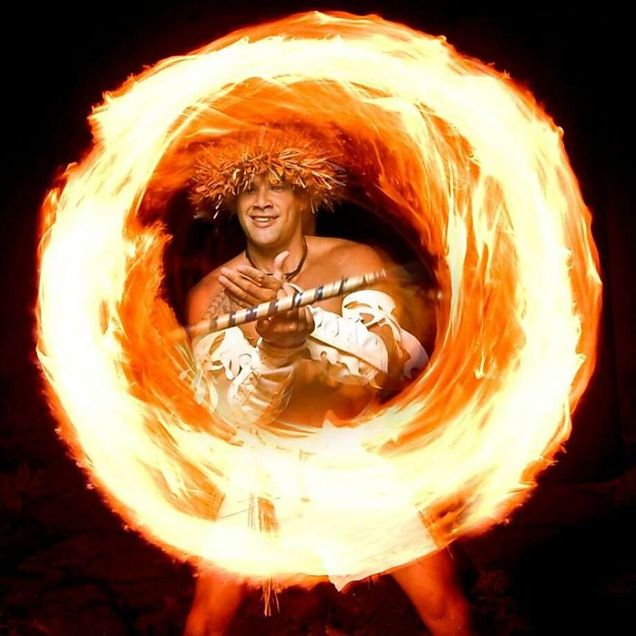 Although it has a Hawaiian focus, the new luau at Sheraton Keauhou Bay still includes the Samoan fire knife dance and other Polynesian revue staples. Photo: Starwood Hawaii