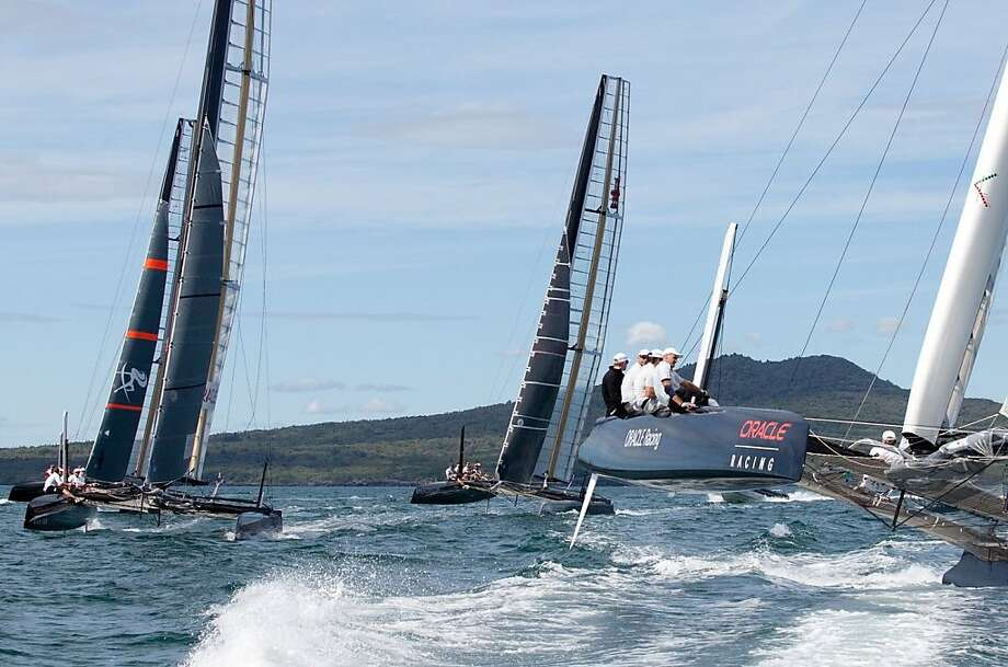 Four out of a newly announced 15 America's Cup teams shown here training heavily in 45-foot catamarans on Hauraki Gulf near Auckland. Photo: Ivor Wilkins / America'scup.com