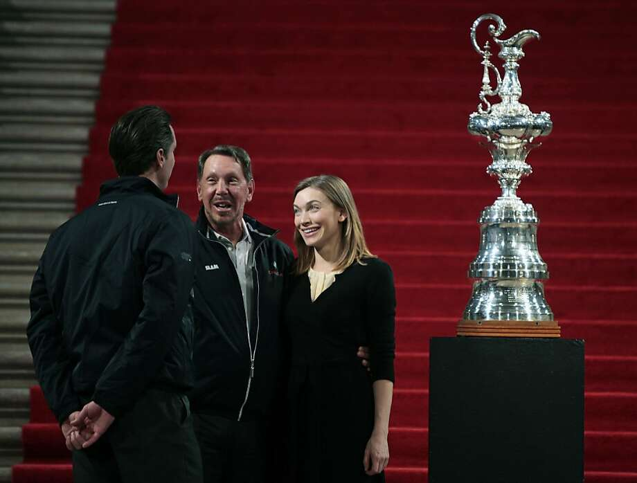 BMW Oracle Racing owner Larry Ellison and his wife Melanie Craft talk with San Francisco Mayor Gavin Newsom at the conclusion of a ceremony Saturday Feb. 20, 2010 in which the Mayor welcomed Ellison and his team back to San Francisco after they won the 33rd America's Cup trophy in Spain.    Ran on: 02-21-2010 Above: Mayor Gavin Newsom (left) chats with team leader Larry Ellison and his wife, Melanie Craft, at the event that drew throngs to City Hall, left. Ran on: 02-21-2010 Photo caption Dummy text goes here. Dummy text goes here. Dummy text goes here. Dummy text goes here. Dummy text goes here. Dummy text goes here. Dummy text goes here. Dummy text goes here.###Photo: amcup21_ph21266537600SFC###Live Caption:BMW Oracle Racing owner Larry Ellison and his wife Maloney Craft talk with San Francisco Mayor Gavin Newsom at the conclusion of a ceremony in which the Mayor welcomed Ellison and his team back to San Francisco after they won the 33rd America's Cup trophy in Spain. Saturday Feb. 20, 2010.###Caption History:BMW Oracle Racing owner Larry Ellison and his wife Maloney Craft talk with San Francisco Mayor Gavin Newsom at the conclusion of a ceremony in which the Mayor welcomed Ellison and his team back to San Francisco after they won the 33rd America's Cup trophy in Spain. Saturday Feb. 20, 2010.###Notes:Lance Iversen Phone 415-297-9395_CQ###Special Instructions:**MANDATORY CREDIT FOR PHOTOG AND SF CHRONICLE-NO SALES-MAGS OUT-TV OUT-INTERNET: AP MEMBER NEWSPAPERS ONLY** Photo: Lance Iversen, The Chronicle