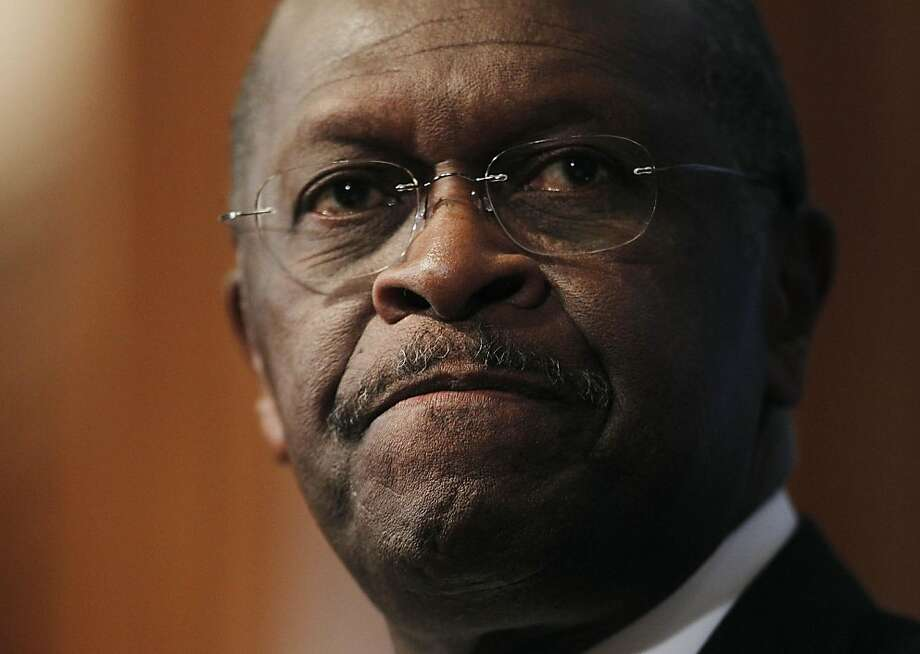 "In this file photo taken Oct. 31, 2011, Republican presidential candidate Herman Cain answers questions at the National Press Club in Washington about sexual harassment allegations.  Sharon Bialek, a Chicago-area woman, accused Cain on Monday, Nov. 7, 2011, of making an unwanted sexual advance against her in 1997. Cain's campaign instantly issued a denial. ""All allegations of harassment against Mr. Cain are completely false,"" it said. (AP Photo/Pablo Martinez Monsivais, File) Photo: Pablo Martinez Monsivais, AP"