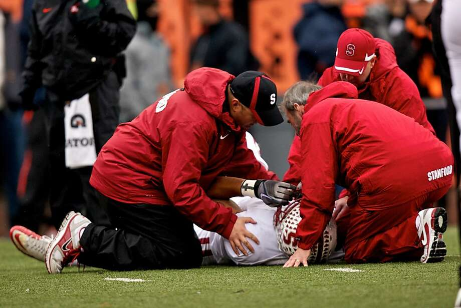 CORVALLIS, OR - NOVEMBER 5: Trainers work on wide receiver Chris Owusu #81 of the Stanford Cardinal on November 5, 2011 at Reser Stadium in Corvallis, Oregon. Owusu was taken off the field via ambulance. (Photo by Craig Mitchelldyer/Getty Images) Photo: Craig Mitchelldyer, Getty Images