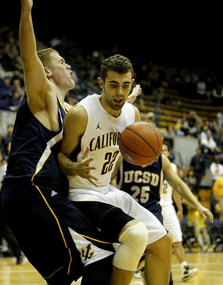 University of California Berkeley's Harper Kamp is foaled by  the University of California San Diego's Christian Hatch in the second half, Tuesday November 1, 2011, at the Haas pavilion in Berkeley, Calif. Photo: Lacy Atkins, The Chronicle