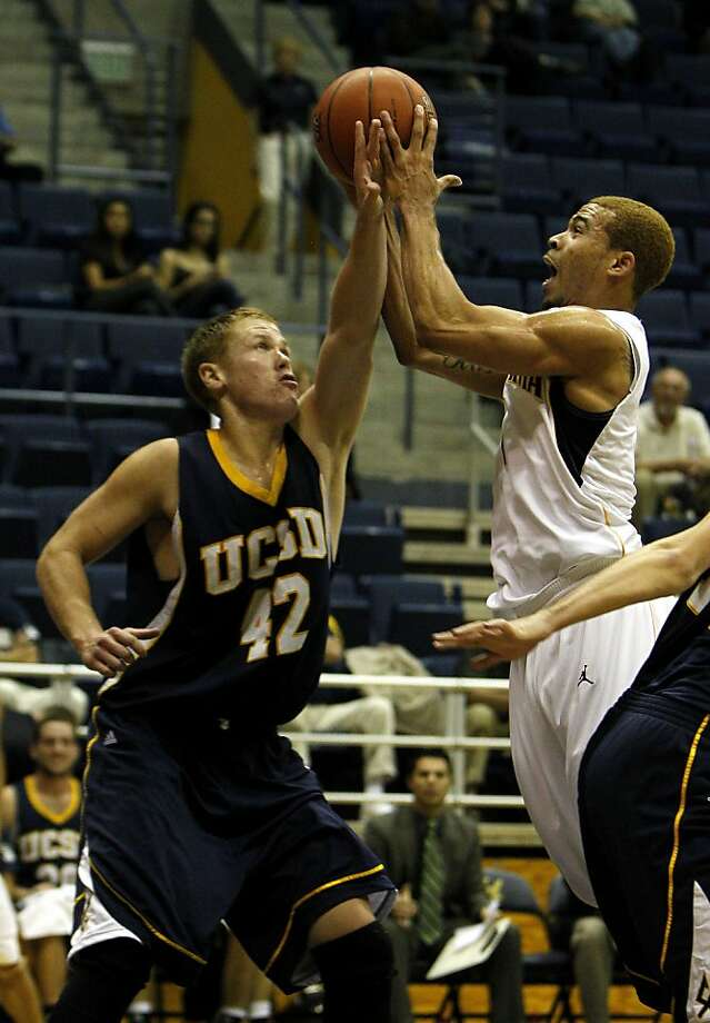 University of California Berkeley Justin Cobbs is foaled by University of California San Diego's Christian Hatch as he makes a basket in the first half of the game,  Tuesday November 1, 2011, at the Haas pavilion in Berkeley, Calif. Photo: Lacy Atkins, The Chronicle