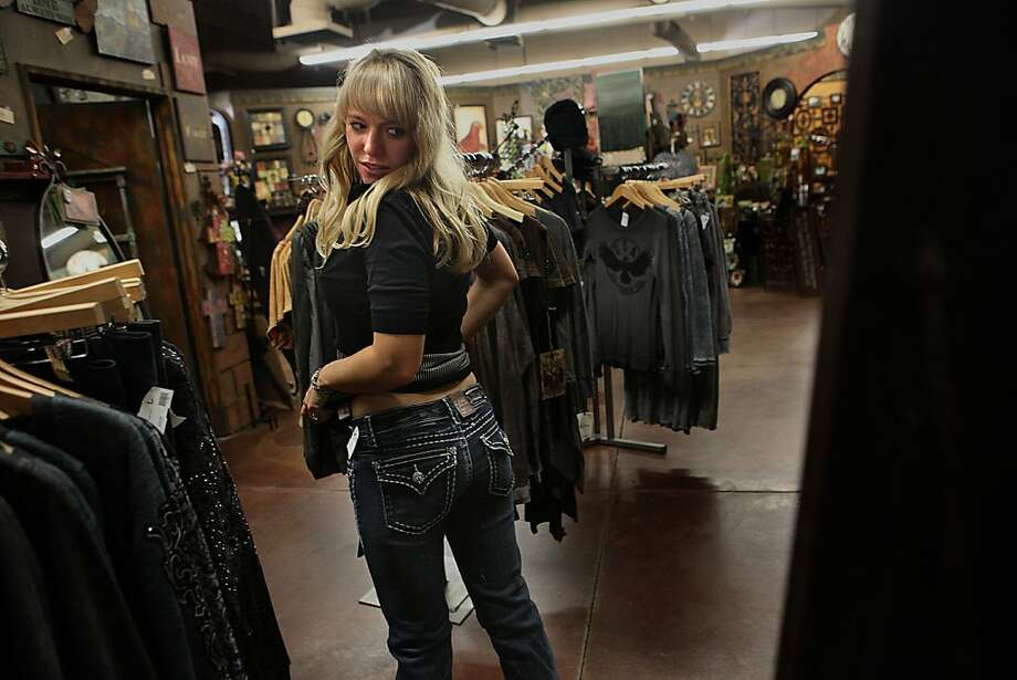 Store manager (name tko) of NIche in Reno, Calif., trying on a pair of newly arrived L.A. idols on Thursday, October 13, 2011, as she considers buying the pair. Photo: Liz Hafalia, The Chronicle