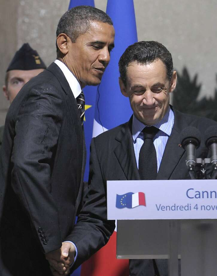 "FILE - In this Friday, Nov. 4, 2011 file photo French President Nicholas Sarkozy and President Barack Obama shake hands as they attend an event at City Hall in Cannes, France. French President Nicolas Sarkozy, who has labored to improve French relations with Israel, said he ""can't stand"" Israeli Prime Minister Benjamin Netanyahu and called him a liar in a conversation with President Barack Obama. (AP Photo/Susan Walsh, File) Ran on: 11-09-2011 President Obama and French President Nicolas Sarkozy shake hands Friday. Photo: Susan Walsh, AP"