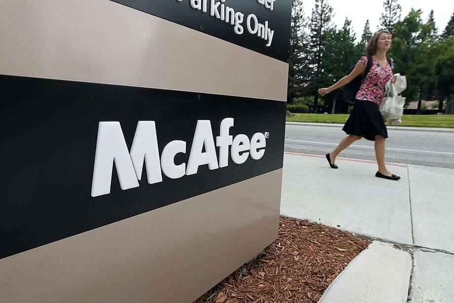 A woman walks past a sign for McAfee Inc. at company headquarters in Santa Clara, California, U.S., on Thursday, Aug. 19, 2010. Intel Corp. agreed to buy McAfee Inc. for $7.68 billion, its largest acquisition, adding security software to its chipmaking arsenal. Photographer: Tony Avelar/Bloomberg   Ran on: 08-29-2010 A shareholder lawsuit puts the future of McAfee of Santa Clara in doubt.  Ran on: 09-30-2010 Intel Corp.'s acquisition of security-software-maker McAfee Inc. of Santa Clara for $7.7 billion was the company's largest. Ran on: 09-30-2010 Intel Corp.'s acquisition of security-software-maker McAfee Inc. of Santa Clara for $7.7 billion was the company's largest. Photo: Tony Avelar, Bloomberg