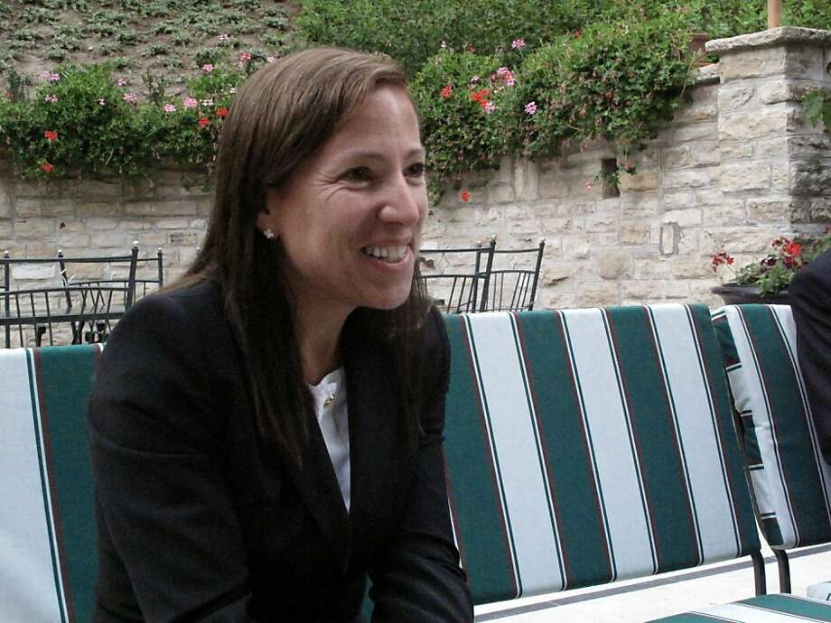 U.S. Ambassador to Hungary Eleni Tsakopoulous Kounalakis talks with American visitors in the garden of her Budapest home. Photo: Leah Garchik, The San Francisco Chronicle