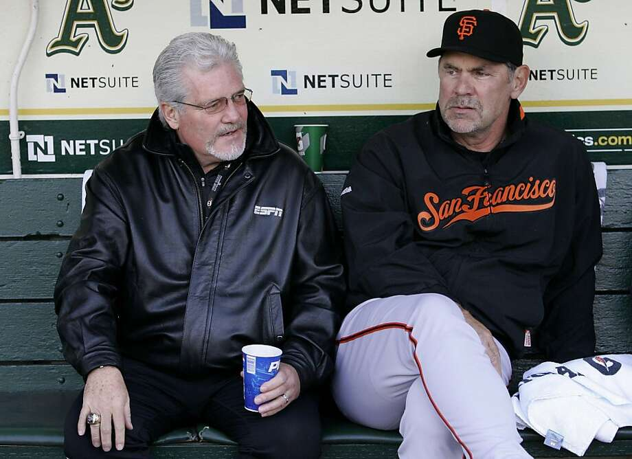 In this photo taken May 21, 2010, San Francisco Giants general manager Brian Sabean, left, talks with manager Bruce Bochy before a baseball game against the Oakland Athletics in Oakland, Calif. Sabean and Bochy received contract extensions taking them through the 2013 season with club options for 2014, moves that were expected this winter. (AP Photo/Jeff Chiu)  Ran on: 11-30-2011 Brian Sabean (left) and Bruce Bochy are now under contract through at least 2013. Photo: Jeff Chiu, AP
