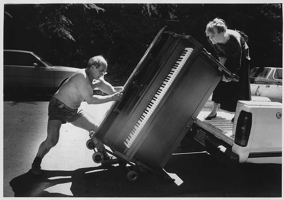 Ed Gong, then 62, moves a piano. The woman on the truck is unidentified.  Photo was taken in June 1988. Photo: Liz Hafalia, The Chronicle