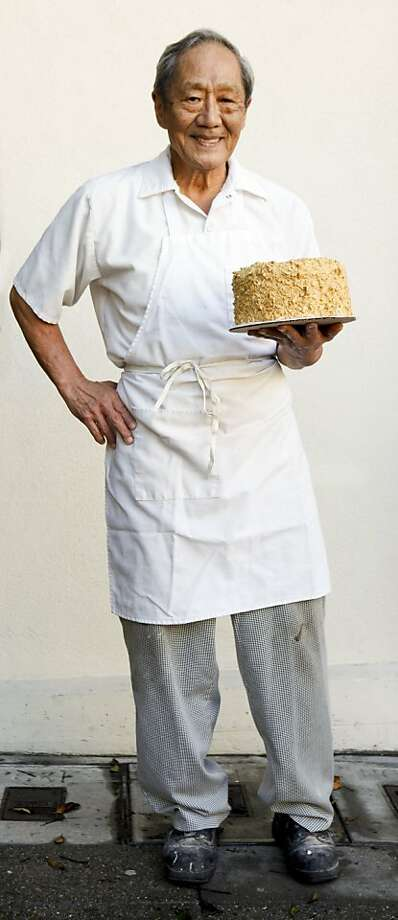 Tom Yasukochi, of Yasukochi's Sweet Stop Bakery, holds one of his trademark coffee crunch cakes on Wednesday, Oct. 5, 2011 in San Francisco, Calif. Photo: Russell Yip, The Chronicle