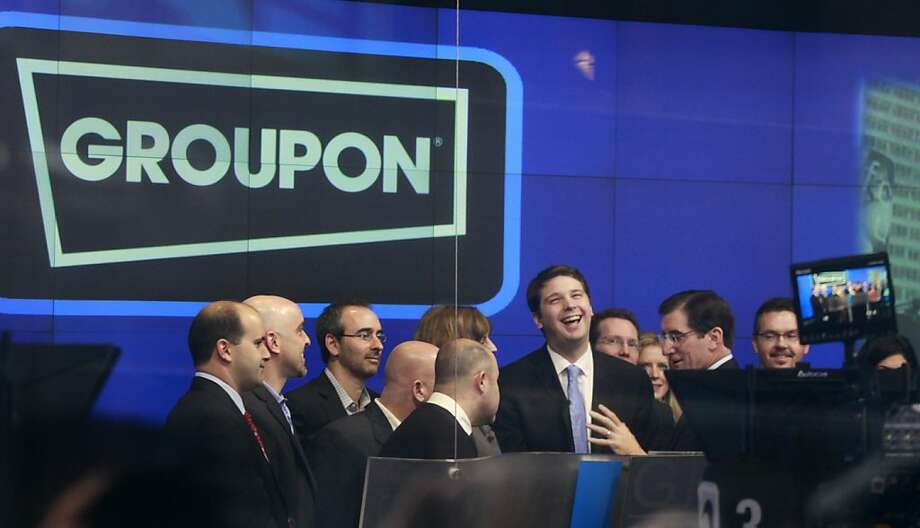 Andrew Mason, founder and CEO of Groupon, attends his company's IPO at Nasdaq, Friday, Nov. 4, 2011 in New York. Groupon, the company that pioneered online group discounts, saw its stock climb by nearly a third in its public debut Friday, showing strong demand for an Internet company whose business model is considered unsustainable by some analysts.(AP Photo/Mark Lennihan)  Ran on: 11-05-2011 Andrew Mason, a co-founder and CEO of Groupon, helps open trading at the Nasdaq Stock Market, where the online daily-deal company started trading. There was strong demand for its stock on the first day.  Ran on: 12-02-2011 Andrew Mason, founder and CEO of Groupon, celebrates his company's initial public offering in November. But, like many other firms with IPOs this year, it turns out Groupon wasn't making a profit after all. Photo: Mark Lennihan, AP