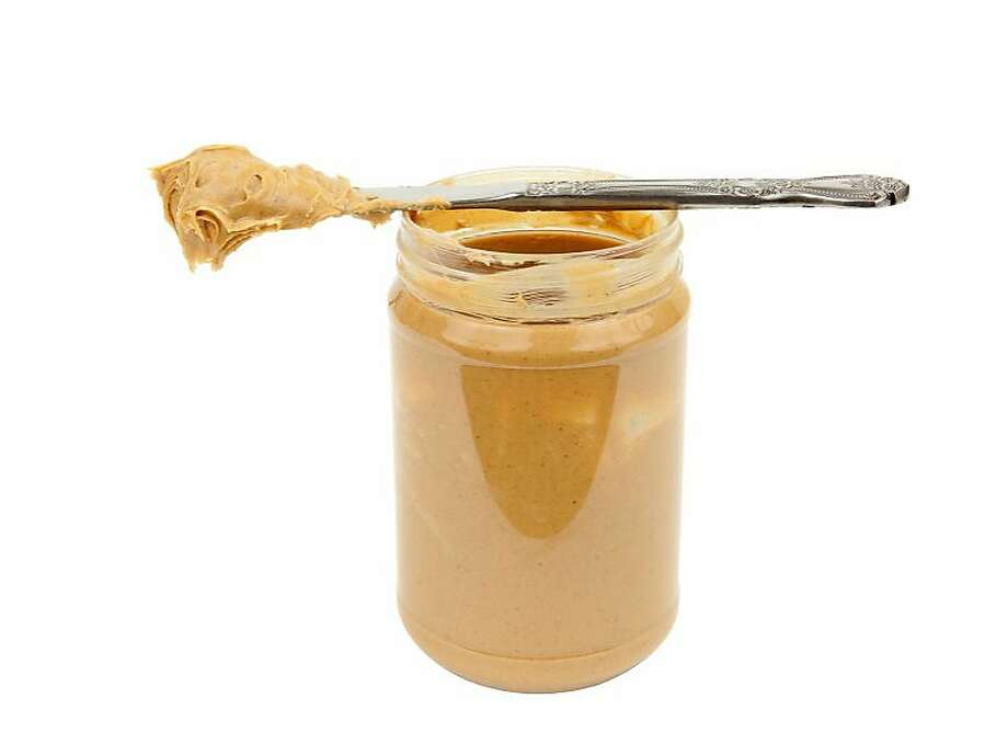 clip art of peanut butter for the H&G story on plants that smell like common foods. Open jar of peanut butter and knife, ready to spread. Isolated on white. Ran on: 02-22-2009  Ran on: 03-15-2009  Ran on: 03-15-2009 Photo: Istockphoto.com Nichols
