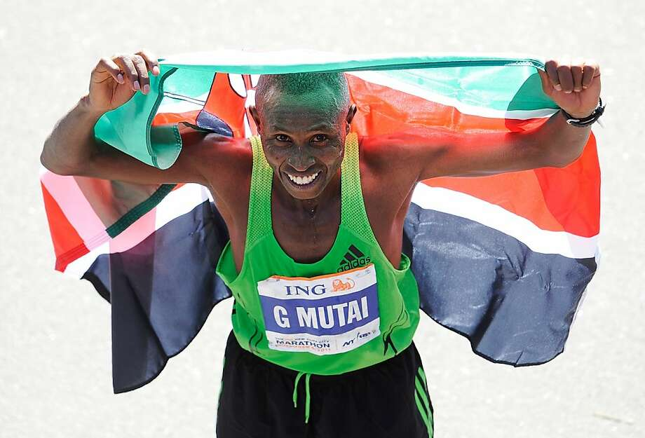 NEW YORK, NY - NOVEMBER 06:  Geoffrey Mutai of Kenya celebrates after winning the Men's Division of the 42nd ING New York City Marathon in Central Park on November 6, 2011 in New York City.  (Photo by Patrick McDermott/Getty Images) *** BESTPIX ***  Ran on: 11-07-2011 Kenya's Geoffrey Mutai exults after shattering the course record in the New York Marathon. Photo: Patrick McDermott, Getty Images