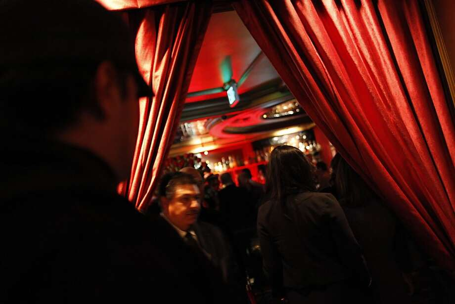 Vajra Granelli, an inspector with the Entertainment Commission, checks in at the Starlight Room on a busy Saturday night. in San Francisco, Calif., November 5, 2011.  Granelli patrols every week, stopping at clubs and bars to check for noise and violence issues. Photo: Sarah Rice, Special To The Chronicle