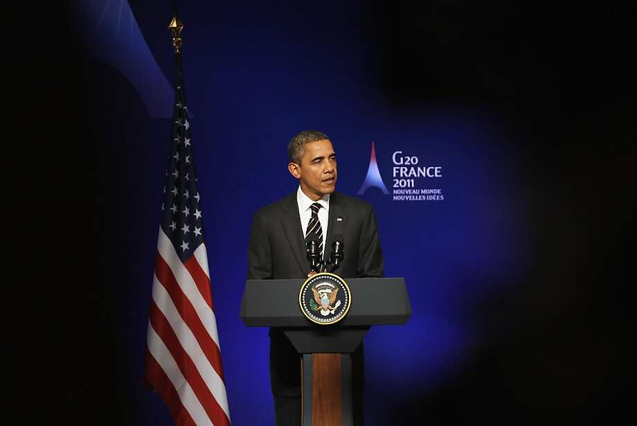CANNES, FRANCE - NOVEMBER 04:  The President of The United States Barack Obama addresses members of the media during a conference on the second and final day of the G20 Summit on November 4, 2011 in Cannes, France. World's top economic leaders are attending the G20 summit in Cannes on November 3rd and 4th, and are expected to debate current issues surrounding the global financial system in the hope of fending off a global recession and finding an answer to the Eurozone crisis.  (Photo by Dan Kitwood/Getty Images) Photo: Dan Kitwood, Getty Images
