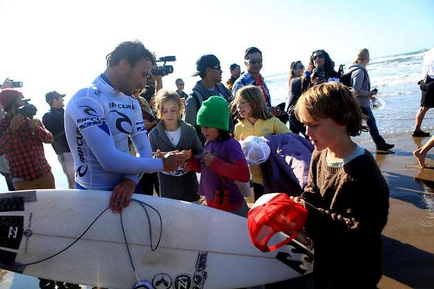 Joel Parkinson of Australia signs autographs for fans after competing in the finals of the Rip Curl Pro Search  surfing competition at Ocean Beach on Monday, November 7, 2011 in San Francisco, Calif.  Gabriel Medina of Brazil won the Rip Curl Pro Search 2011 competition. Photo: Lea Suzuki, The Chronicle