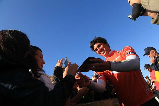Gabriel Medina of Brazil signs autographs for fans after winning the Rip Curl Pro Search surfing competition at Ocean Beach on Monday, November 7, 2011 in San Francisco, Calif. Photo: Lea Suzuki, The Chronicle