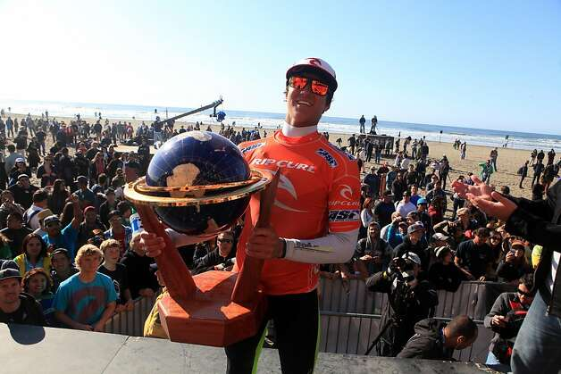 Gabriel Medina of Brazil holds his trophy after winning the Rip Curl Pro Search surfing competition at Ocean Beach on Monday, November 7, 2011 in San Francisco, Calif. Photo: Lea Suzuki, The Chronicle