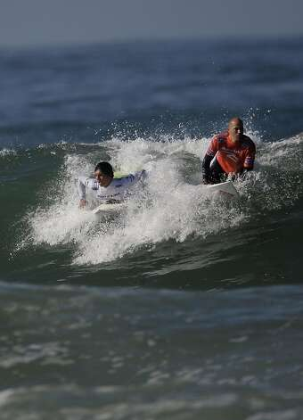 Gabriel Medina of Brazil (l to r) and Kelly Slater of the USA are seen on a wave during the quarter finals of the Rip Curl Pro Search surfing competition at Ocean Beach on Monday, November 7, 2011 in San Francisco, Calif.  Medina won the Rip Curl Pro Search 2011 competition. Photo: Lea Suzuki, The Chronicle