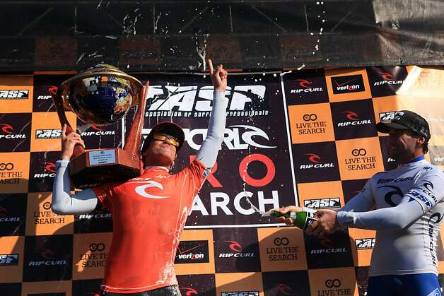 Gabriel Medina (l to r) of Brazil celebrates his win in the Rip Curl Pro Search  surfing competition as Joel Parkinson of Australia sprays him with champagne at Ocean Beach on Monday, November 7, 2011 in San Francisco, Calif.  Medina won the Rip Curl Pro Search 2011 competition. Photo: Lea Suzuki, The Chronicle