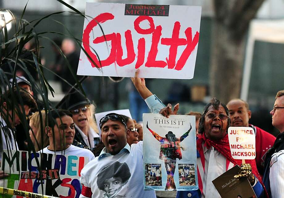 TOPSHOTS Supporters of Michael Jackson hold placards outside the courthouse awaiting the verdict of his doctor's trial in Los Angeles on November 7, 2011 in southern California. Michael Jackson's doctor Conrad Murray was found guilty of involuntary manslaughter over the King of Pop's 2009 death, the court clerk said. There was a brief cry in the courtroom, and cheers outside, but Murray himself gave no reaction when the long-awaited verdict was announced after a six-week trial in Los Angeles.    TOPSHOTS / AFP PHOTO / Frederic J. BROWN (Photo credit should read FREDERIC J. BROWN/AFP/Getty Images) Photo: Frederic J. Brown, AFP/Getty Images