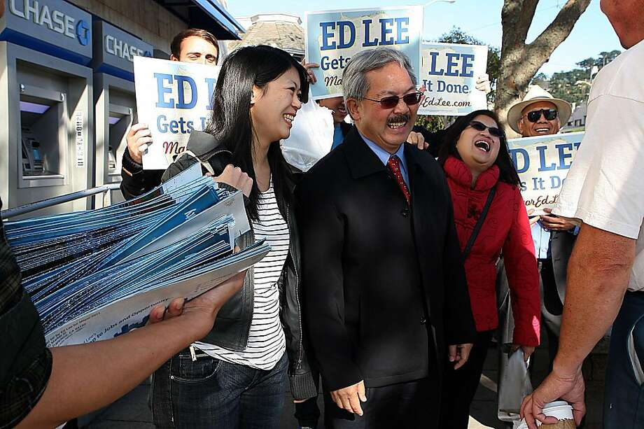 Mayor Ed Lee (middle) greeting west portal residents during the lunch hour in San Francisco, Calif., with his daughter Brianna Lee (left), 26 years old, and his wife Anita Lee (red coat) on Monday, November 7, 2011. Ran on: 11-08-2011 Ed Lee campaigns with his daughter, Brianna, and wife, Anita. Photo: Liz Hafalia, The Chronicle