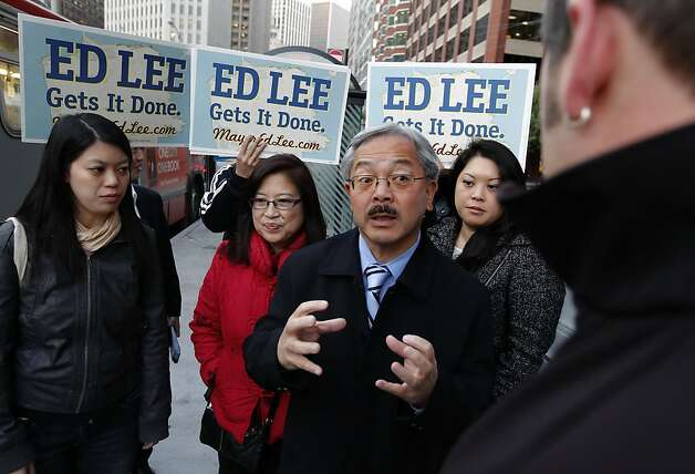 Mayor Ed Lee, with his daughters, Briana, (left) and Tania, (right) and his Wife Anita close by, while he does some last minute campaigning on Election Day at the corner of Howard and Main streets in downtown in San Francisco, Ca. on Tuesday November 08, 2011. Photo: Michael Macor, The Chronicle