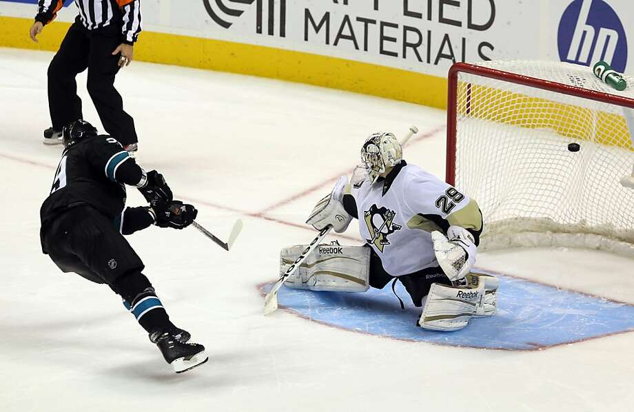SAN JOSE, CA - NOVEMBER 03:  Ryane Clowe #29 of the San Jose Sharks scores the winning goal against Marc-Andre Fleury #29 of the Pittsburgh Penguins in an overtime shoot out at HP Pavilion at San Jose on November 3, 2011 in San Jose, California.  (Photo by Ezra Shaw/Getty Images) Photo: Ezra Shaw, Getty Images