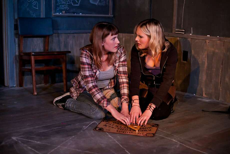 "Penny (Luisa Frasconi, right) and Breanna (Caitlyn Tella) try to summon the spirit of a missing high school classmate in Impact Theatre's staging of Joshua Conkel's ""The Chalk Boy"" Photo: Cheshire Isaacs"