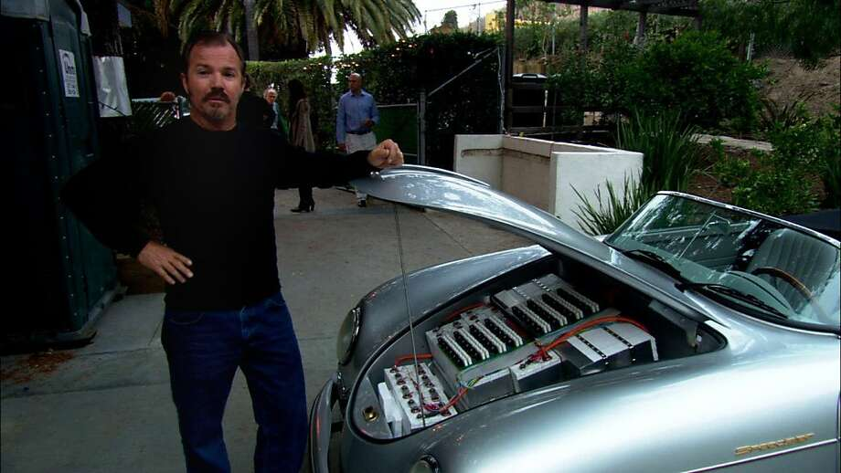 "Greg ""Gadget"" Abbott showing the batteries in his converted car in a scene from, ""Revenge of the Electric Car."" Photo: Area23a"