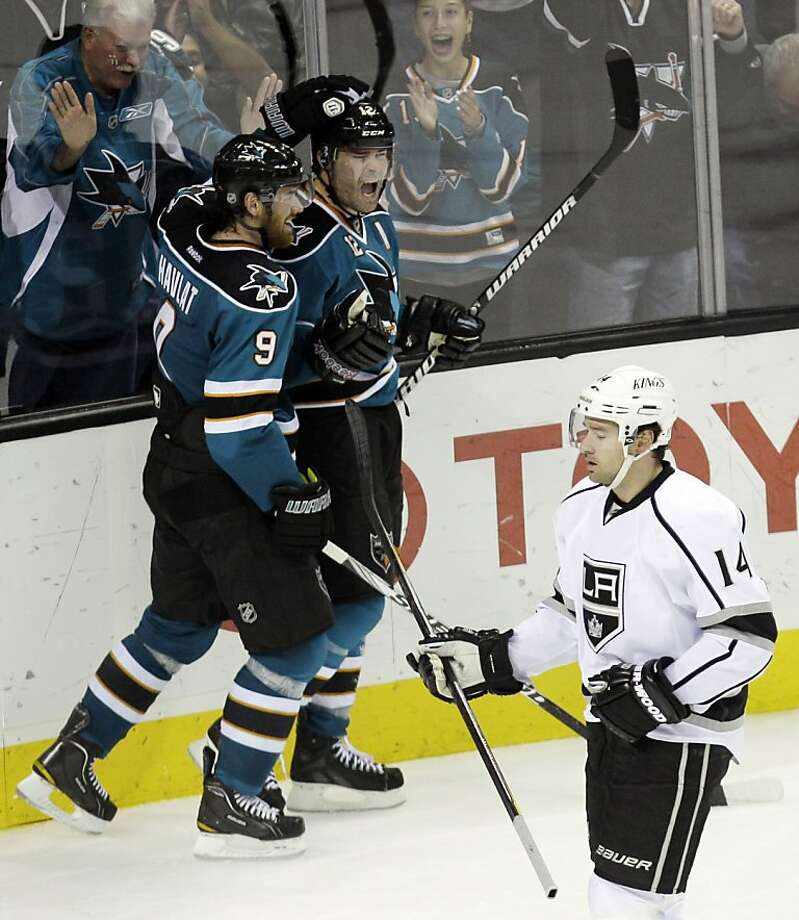 San Jose Sharks left wing Patrick Marleau (12) celebrates his goal with teammate Martin Havlat (9) as Los Angeles Kings right wing Justin Williams (14) looks on during the second period of an NHL hockey game in San Jose, Calif., Monday, Nov. 7, 2011. (AP Photo/Marcio Jose Sanchez)  Ran on: 11-08-2011 Patrick Marleau (center) gets a pat on the head from Martin Havlat after putting the Sharks in front in the second period. Ran on: 11-08-2011 Patrick Marleau (center) gets a pat on the head from Martin Havlat after putting the Sharks in front in the second period. Photo: Marcio Jose Sanchez, AP