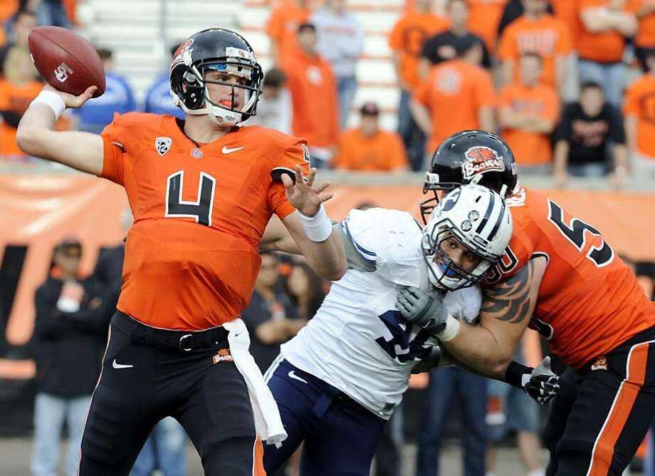Oregon State's quarterback Sean Mannion (4) throws against BYU during the first second half of an NCAA college football game in Corvallis, Ore., Saturday Oct. 15, 2011. (AP Photo/Greg Wahl-Stephens)  Ran on: 11-04-2011 Sean Mannion has impressed his coach at Oregon State with his poise and toughness. Photo: Greg Wahl-Stephens, AP