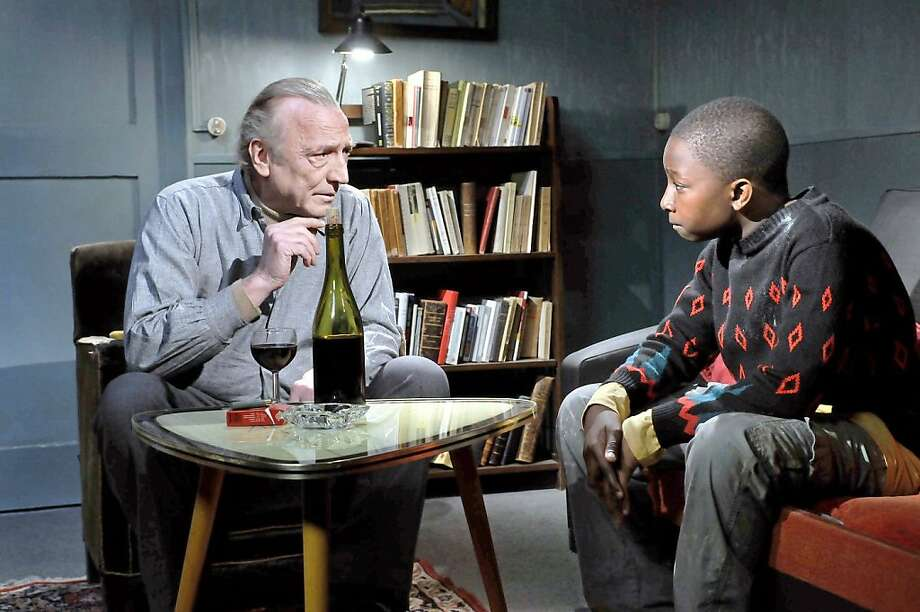 Andre Wilms, left, and Blondin Miguel in LE HAVRE Photo: Pandora Filmproduktion, Outnow.ch