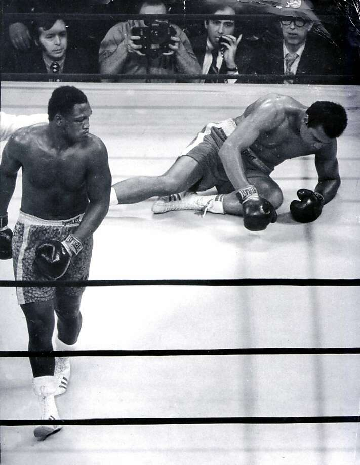 In this 1971 file photo, Joe Frazier heads for a neutral corner, as a dazed Muhammad Ali struggles to stand during their heavyweight championship in New York City. Frazier, the former heavyweight champion, has died. He was 67. (Elwood P. Smith/Philadelphia Daily News/MCT) Photo: Elwood P. Smith, MCT