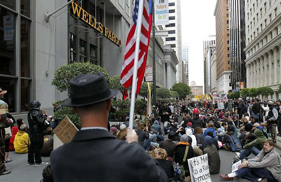 "The crowd makes a stop in front of the Wells Fargo Bank on California street, as Occupy SF protesters make their way through downtown, with the theme ""Move your Money Out of Banks Day"" in San Francisco, Ca. on Saturday November 05, 2011. Photo: Michael Macor, The Chronicle"