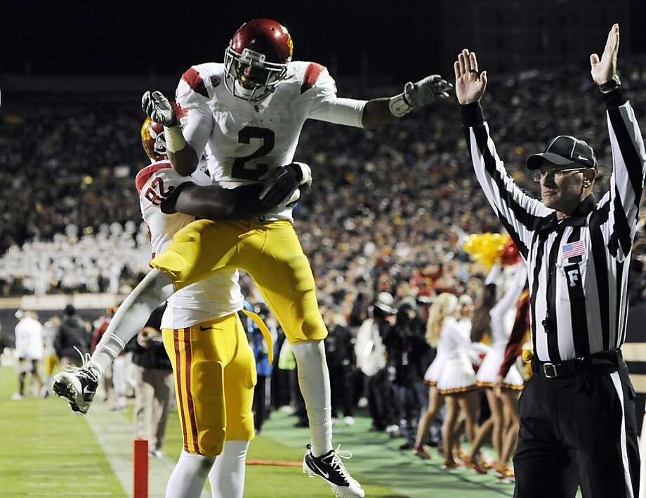 USC wide receiver Robert Woods (2) celebrates a touchdown against Colorado during the first half of an NCAA football game in Boulder, Colo., Friday, Nov. 4, 2011. (AP Photo/Jack Dempsey)  Ran on: 11-05-2011 USC's Robert Woods celebrates after catching a 15-yard touchdown pass from Matt Barkley. It was Barkley's third touchdown pass of the game; he went on to throw three more. Photo: Jack Dempsey, AP