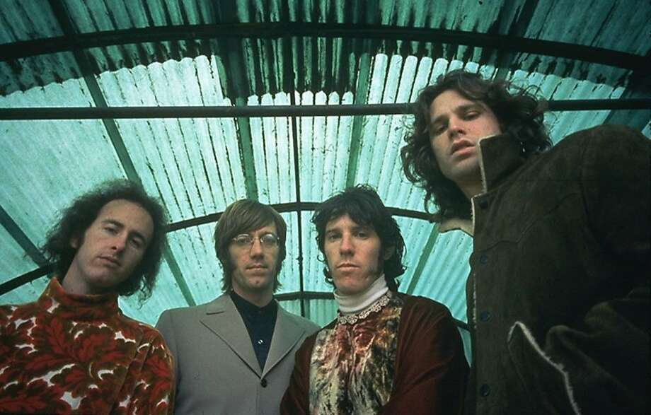 "Musicians, left to right, Robby Krieger, Ray Manzarek, John Densmore and Jim Morrison of The Doors pose in this undated handout photo released to the media on Wednesday, April 7, 2010. ""When You're Strange"" is a documentary film about the influential rock group. Photographer: Paul Ferrara/Rhino Media via Bloomberg  EDITOR'S NOTE: NO SALES. EDITORIAL USE WITH PREVIEW/REVIEW OF MOVIE ONLY.  Ran on: 04-09-2010 Doors members (from left) Robby Krieger, Ray Manzarek, John Densmore and Jim Morrison in an undated photo appear in a series of archive clips in &quo;When You're Strange.&quo; Photo: Paul Ferrara, Via Bloomberg"
