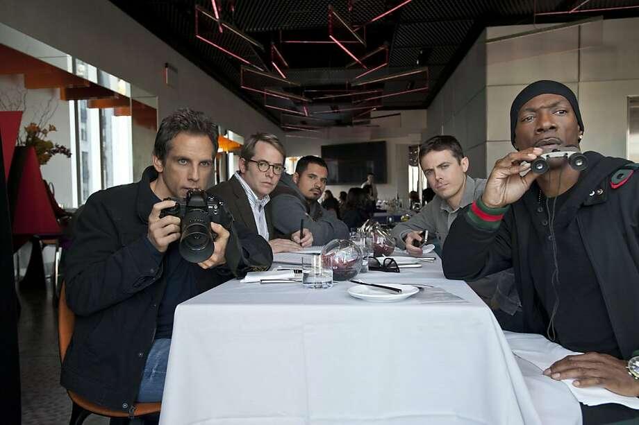 "(L to R) Josh (BEN STILLER), Mr. Fitzhugh (MATTHEW BRODERICK), Dev'Reaux (MICHAEL PE""A), Charlie (CASEY AFFLECK) and Slide (EDDIE MURPHY) conduct surveillance in ""Tower Heist"", an action-comedy about working stiffs who seek revenge on the Wall Street swindler who stiffed them. Photo: David Lee, Universal Pictures"