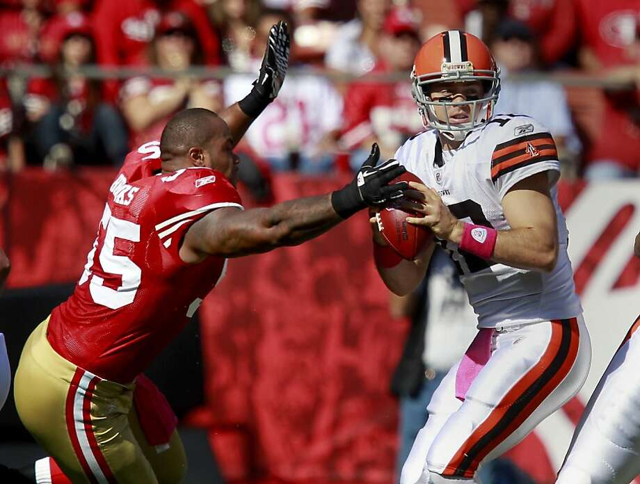 Ahmad Brooks (55), without a helmet, got to Browns quarterback Colt McCoy in the first quarter and forced a fumble. The San Francisco 49ers defeated the Cleveland Browns 20-10 at Candlestick Park Sunday October 30, 2011. Photo: Brant Ward, The Chronicle