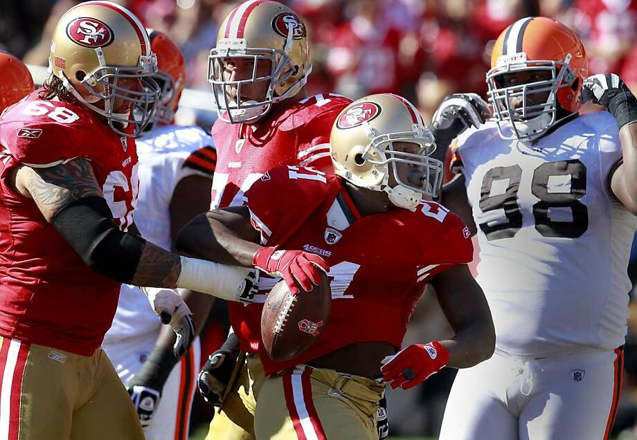 Adam Snyder grabbed Frank Gore after his first half touchdown. The San Francisco 49ers defeated the Cleveland Browns 20-10 at Candlestick Park Sunday October 30, 2011. Photo: Brant Ward, The Chronicle