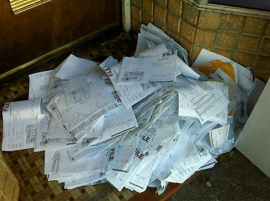 After a Jackson Hewitt tax preparation office got evicted from 1734 Divisadero in San Francisco for not paying rent, the building owner removed old tax returns in late October and left them on the sidewalk to be picked up by a shredding service that didn't show up. Photo: Courtesy Photo