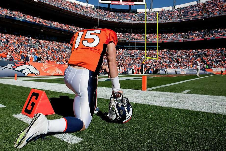 DENVER, CO - OCTOBER 30:  Quarterback Tim Tebow #15 of the Denver Broncos prays before a game against the Detroit Lions at Sports Authority Field at Mile High on October 30, 2011 in Denver, Colorado. (Photo by Justin Edmonds/Getty Images) Photo: Justin Edmonds, Getty Images