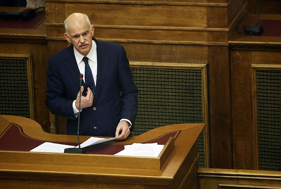 George Papandreou, Greece's prime minister, speaks to members of the parliament in Athens, Greece, on Thursday, Nov. 3, 2011. Papandreou reached out to the opposition about setting up a transitional government, indicating an accord would secure aid and remove the need for a referendum on euro membership. Photographer: Angelos Tzortzinis/Bloomberg *** Local Caption *** George Papandreou Photo: Angelos Tzortzinis, Bloomberg