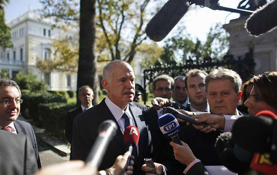 Greece's Prime Minister George Papandreou addresses the media after his meeting with Greek President Karolos Papoulias, at the presidential house in Athens on Saturday, Nov. 5, 2011. Embattled Greek Prime Minister George Papandreou launched efforts to form a four-month coalition government, arguing the move is vital to demonstrating Greece's commitment to remaining in the eurozone.(AP Photo/Kostas Tsironis) Ran on: 11-06-2011 Prime Minister George Papandreou talks with reporters after his meeting with the president. Photo: Kostas Tsironis, AP