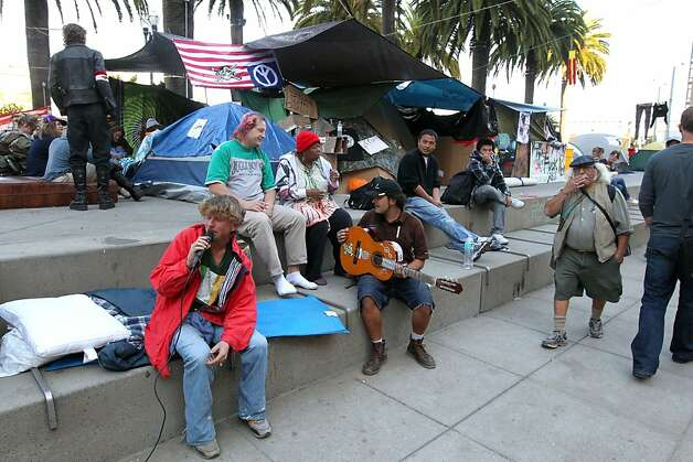 Participants in Occupy San Francisco at Justin Herman Park pass the time playing music as tourist visit the encampment Thursday Oct 27, 2011. Photo: Lance Iversen, The Chronicle